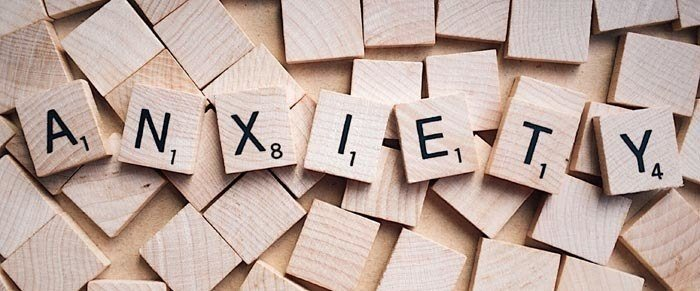 scrabble letters spelling anxiety