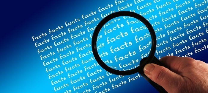 the word facts under magnifying glass